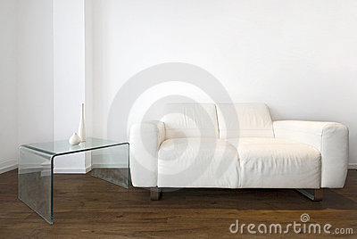 Living room detail with a white leather sofa