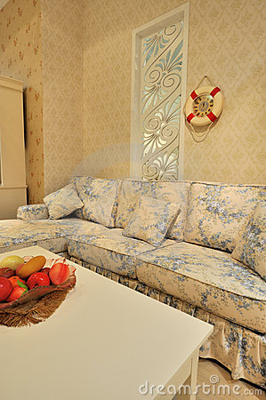 Living room with flowery sofa
