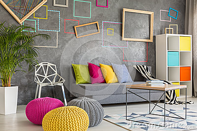 living room with wool poufs stock photo image 79161215