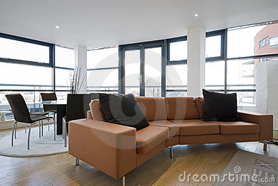 Livingroom with large orange sofa
