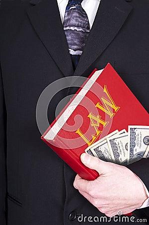 Livro de lei da terra arrendada do advogado, dinheiro, corrupção