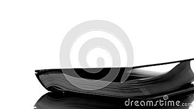 Livro negro pesado que cai na superfície do branco video estoque