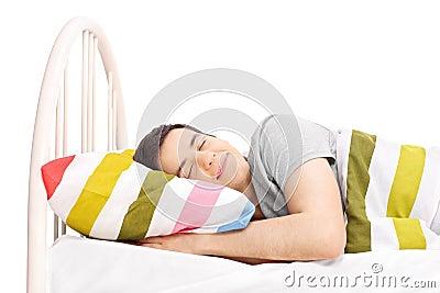 Lo studio ha sparato di un uomo spensierato che dorme a letto fotografia stock immagine 50890688 - Impazzire un uomo a letto ...