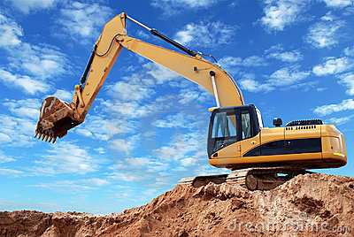 Loader excavator with raised boom