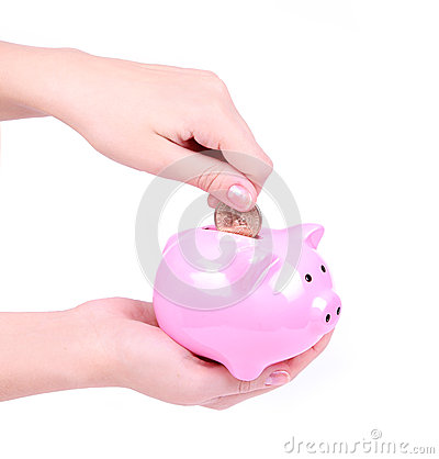 Loading a piggy bank isolated on white