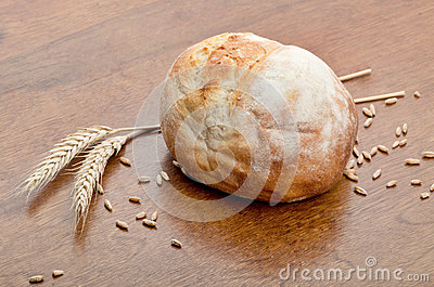 Loaf of bread with grains of wheat