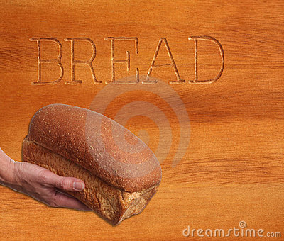 Loaf of bread, hand held.