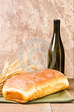 Loaf of bread with wine bottle
