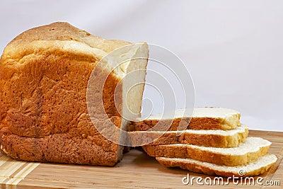Loaf of homemade white bread sliced