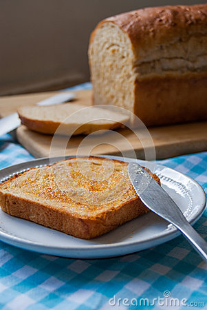 Loaf and sliced bread on blue table cloth