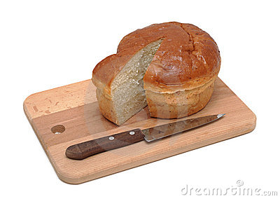 Loaf of sliced bread on a wooden board