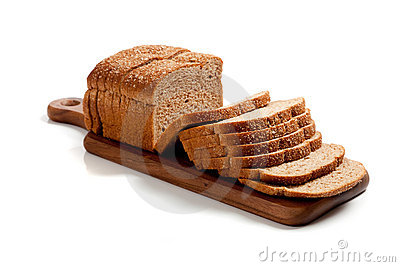 A loaf of sliced wheat bread on a cutting board