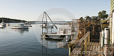 Lobster boat and pots on wharf