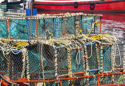 Lobster cages on boat in harbour
