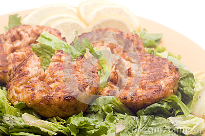 Lobster cakes  bed of lettuce with lemon slice wedges