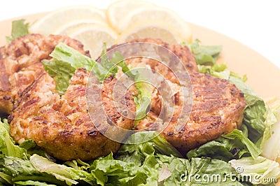 Lobster cakes  bed of lettuce with lemon slice wedges