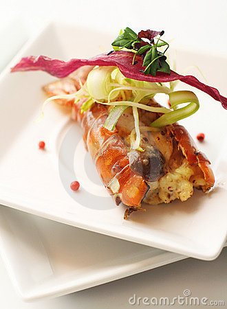 Lobster with melted cheese, topped with vegetable