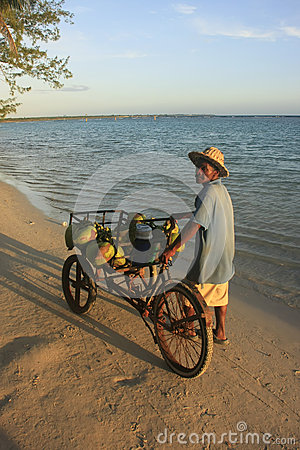 Local man selling coconuts at Boca Chica beach Editorial Stock Photo