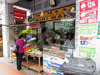 Locals buying fruit and sim card stall Editorial Stock Photo