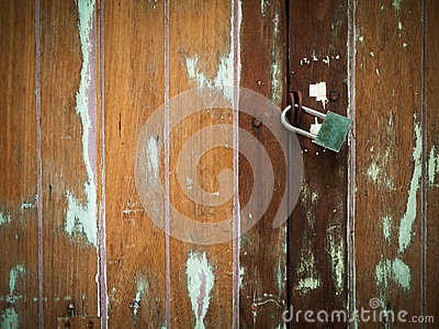 Lock on Plank Cracked Wood Door