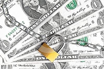 Lock security and chain on dollars banknotes background