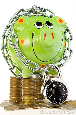 Free Locked Piggy Bank On Coins Stock Images - 5837264