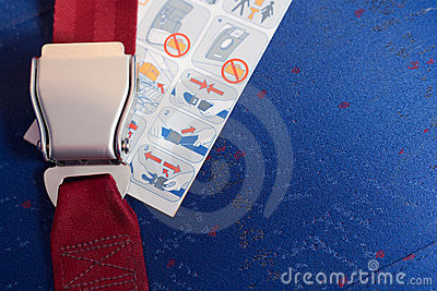 Locked seatbelt and instruction lay on the chair. Editorial Stock Photo