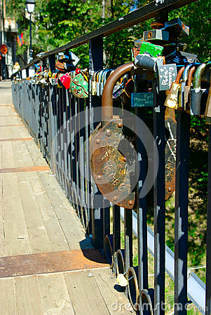 Locks on the railing of the bridge