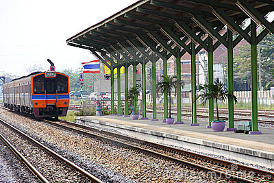 Locomotive arrived to railway station, Thailand.