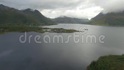 Lofoten peninsula and fjord aerial. Aerial shot above an iconic and popular tourism viewpoint in Lofoten, Norway stock video