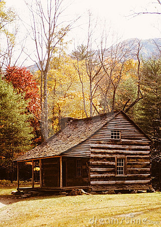 Log Cabin among Autumn Trees