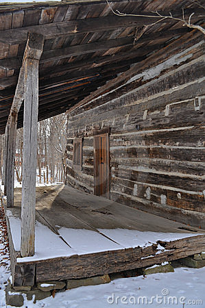Log cabin porch in winter