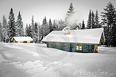 Log cabin in snow