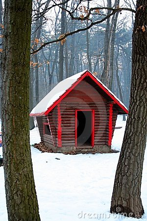 Log cabin in snow woods