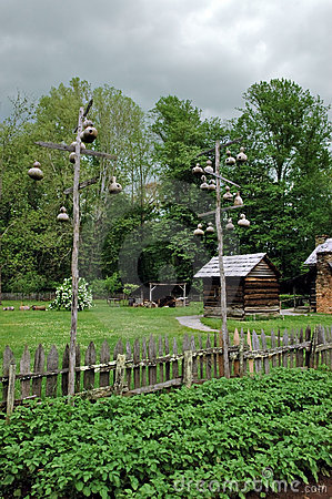 Free Log Cabin With Gord Bird Houses. Royalty Free Stock Image - 11244046