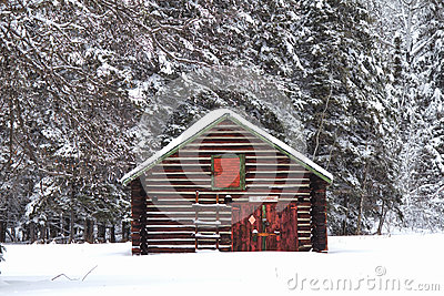 A log shed in the snow