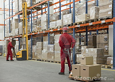 Logistic - workers in storehouse