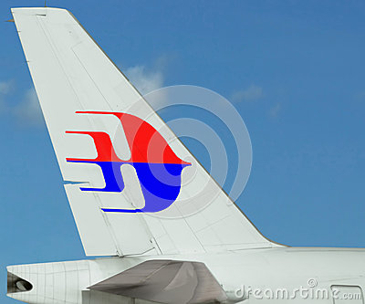 Malaysia Airlines plane. Logo on tail. Blue sky Editorial Stock Photo