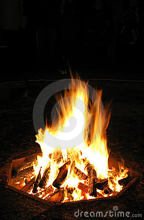 Logs burning on campfire