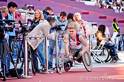 London 2012: athlete on wheelchair interviewed Editorial Stock Photo