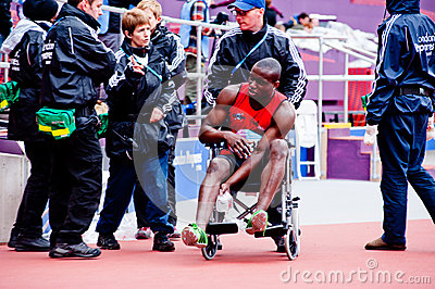 London 2012: injured athlete on wheelchair Editorial Stock Image