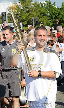 London 2012 Olympic Torch Bearer Editorial Stock Photo