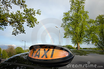 London Black Taxi Cab and Rainbow