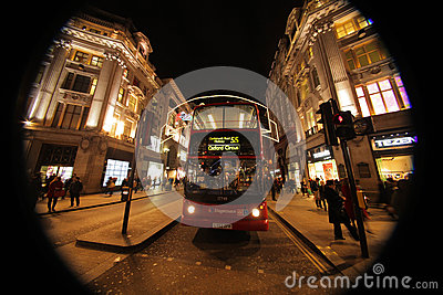 London bus at Oxford Street at night Editorial Stock Image