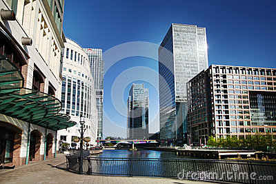 LONDON, CANARY WHARF UK - APRIL 13, 2014 - Modern glass architecture of Canary Wharf business aria, headquarters for banks Editorial Stock Photo