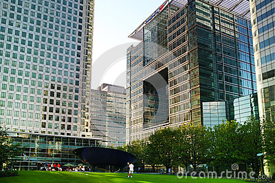 LONDON, CANARY WHARF UK - APRIL 13, 2014 - Modern glass architecture of Canary Wharf business aria, headquarters for banks Editorial Photography