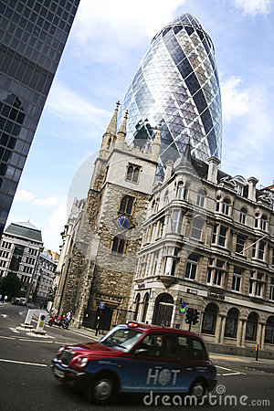 London city taxi cab driving past gherkin building Editorial Photography