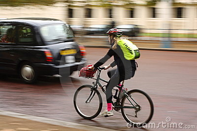 London Cyclist in Motion Editorial Photography