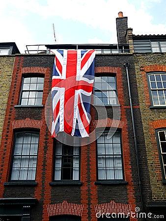 London: East End Georgian terrace house with flag