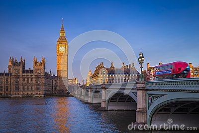 London, England - The iconic Big Ben with Houses of Parliament and traditional red double decker bus Stock Photo